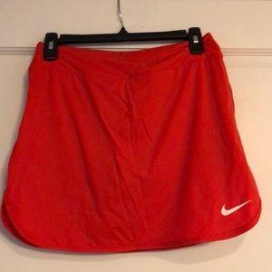 Nike dry fit Women S orange runners/tennis skirt